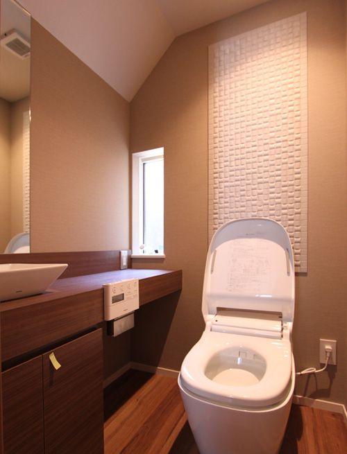 1階のトイレはホテル風の落ち着いた空間となりました。